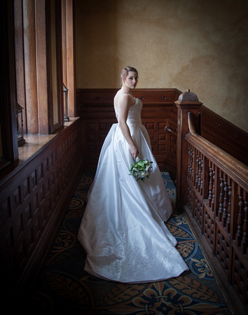 A  Bride stands at the top of a staircase moments before her Wedding.