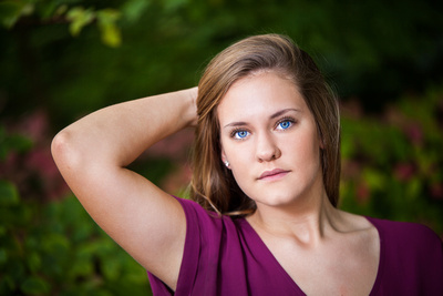 A High School Senior with big blue eyes poses for her Senior Portraits with Memories in Time Photography