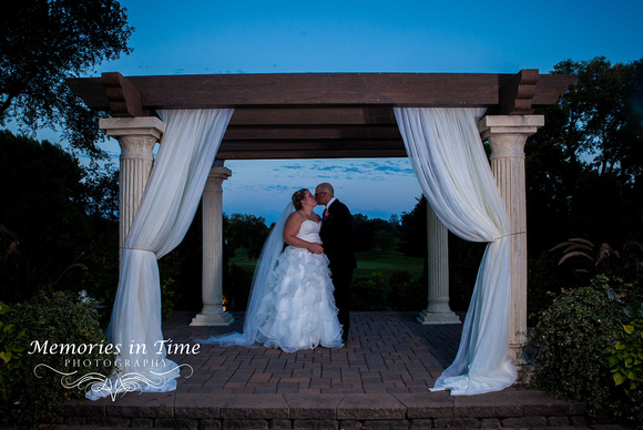 A Twilight kiss between a newly married couple at Brackett's Crossing Country Club