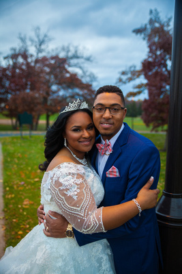 A wedding couple poses in the lush colors of fall in St. Paul, Minnesota